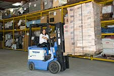 fork lift operator in warehouse